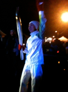Olympian holding a torch in Tofino